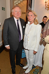 LORD & LADY BAMFORD at a breakfast hosted by Zita West and Leo Bamford to launch a range of vitamins for babies & children held at the Royal Society of Medicine, Chandos House, 2 Queen Anne Street, London on 21st May 2015.