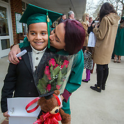 FAIRFAX, VA -DEC21: Emerita Ayala, 23, kisses her son Dominic, 8, after her graduation from George Mason University, December 21, 2016, in Fairfax, Virginia. Emerita started as a teenage mom at 18, with her 3-year-old son at community college, then went on to earn her bachelors degree from George Mason University. She got help through a nonprofit called Generation Hope that provides scholarships and mentoring to teenage moms. (Photo by Evelyn Hockstein/For The Washington Post)