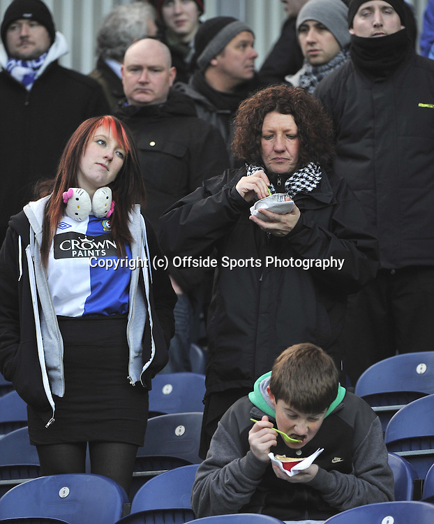 18/12/2010  Blackburn Rovers v West Ham United<br />Barclays Premier League<br />Fans eat their pies during the game at Ewood Park<br />Credit Roy Beardsworth<br />COPYRIGHT OFFSIDE SPORTS PHOTOGRAPHY