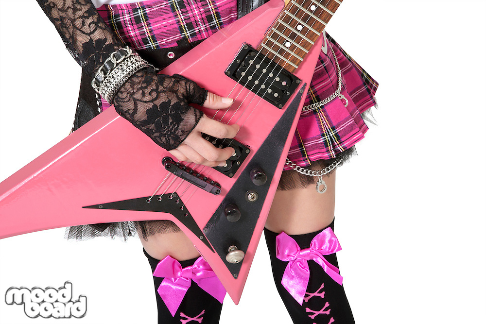 Close-up of punk woman with guitar over white background
