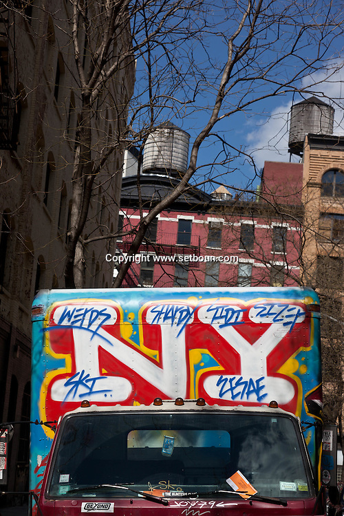 New York. truck covered with graffitis  on Houston street;