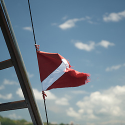 Divers flag in the breeze.