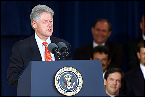 president clinton addresses the audience at the awards ceremony during the president's cup challenge in virginia.