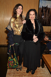 Left to right, BELLA FREUD and BIANCA JAGGER at the Louis Vuitton for Unicef Event #MAKEAPROMISE held at The Apartment, 17-20 New Bond Street, London on 14th January 2016.