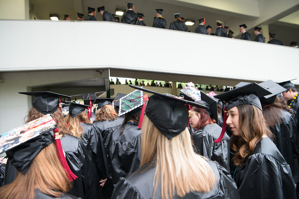 Michelle Jacobson (Lower Right) talks with friends during undergraduate commencement ceremonies. Photo by Ben Siegel
