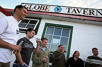 Drinks are shared outside of the Globe Tavern, a popular bar in Stanley, the capital of the Falkland Islands, on Saturday, March 17, 2007. This year is the 25 anniversary of the war for sovereignty of the islands between the United Kingdom and Argentina. The two-month war resulted in the withdrawal of Argentinean forces and the islands remained part of the United Kingdom. (Photo/Scott Dalton)