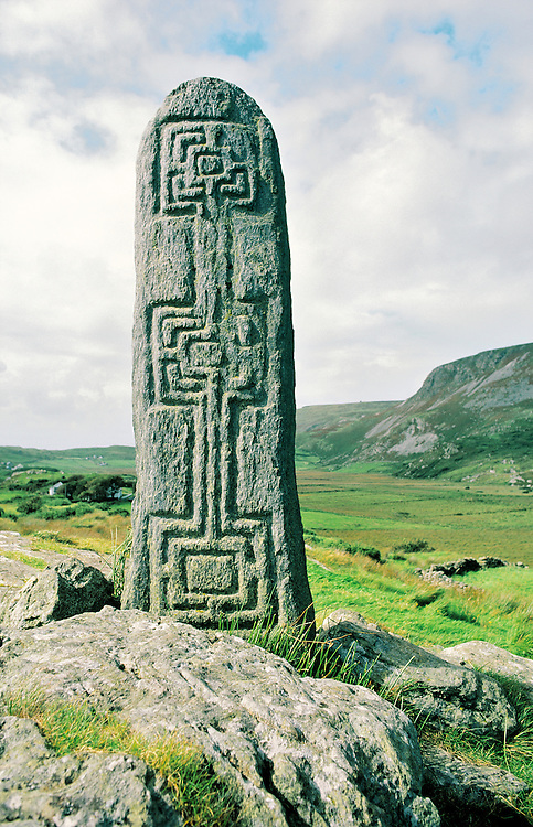 Celtic Christian stone carving in the valley of Glencolumbkille, Donegal, Ireland. One of the pilgrimage circuit stations.