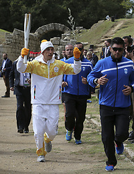 OLYMPIA, Oct. 24, 2017  The first torchbearer, Greek cross country skiing athlete Apostolos Aggelis (front L) runs with the Olympic flame and an olive branch during the Olympic flame lighting ceremony for the PyeongChang 2018 Winter Olympic Games in ancient Olympia, Greece, on Oct. 24, 2017. (Credit Image: © Mrios Lolos/Xinhua via ZUMA Wire)