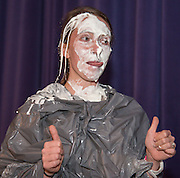 Chavez High School freshman math teacher Karen Christianson reacts after getting a pie in face during a rally for STAAR, March 27, 2014.