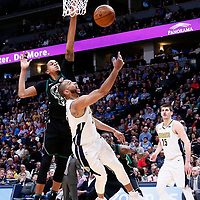 01 April 2018: Denver Nuggets guard Devin Harris (34) goes for the layup past Milwaukee Bucks center John Henson (31) during the Denver Nuggets 128-125 victory over the Milwaukee Bucks, at the Pepsi Center, Denver, Colorado, USA.