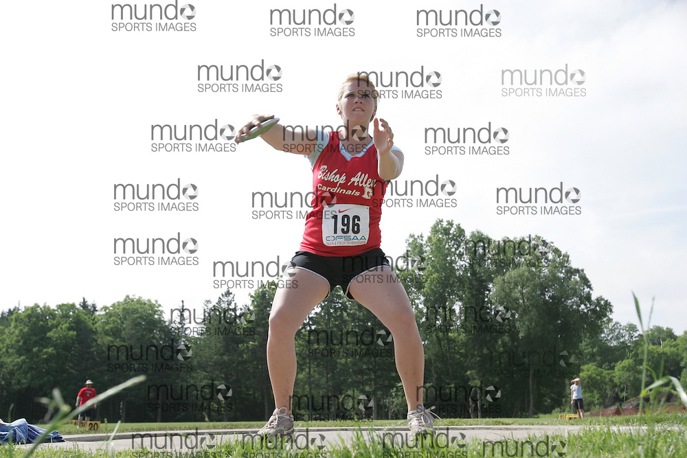 (London, Ontario}---04 June 2010) Carly Goldup of Bishop Allen Academy-Etobicoke competing in the Discus at the 2010 OFSAA Ontario High School Track and Field Championships. Photograph copyright Sean Burges / Mundo Sport Images, 2010.
