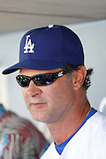 LOS ANGELES, CA - JUNE 30:  Manager Don Mattingly #8 of the Los Angeles Dodgers talks to the media before the game against the New York Mets on Saturday, June 30, 2012 at Dodger Stadium in Los Angeles, California. The Mets won the game in a 5-0 shutout. (Photo by Paul Spinelli/MLB Photos via Getty Images) *** Local Caption *** Don Mattingly