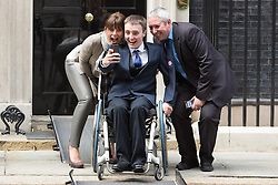 © Licensed to London News Pictures. 17/03/2014. London, UK. Davina McCall poses for a selife outside Downing Street with guests at a Sport Relief reception hosted by the Prime Minister, David Cameron on 17th March 2014. Photo credit : Vickie Flores/LNP