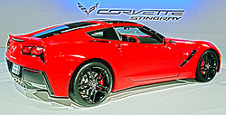 "08  February 2013: 2014 Chevrolet Corvette Stingray sports car. Chicago Auto Show, Chicago Automobile Trade Association (CATA), McCormick Place, Chicago Illinois..2014 CHEVROLET CORVETTE STINGRAY: Crowds will be swarming to the Chevrolet exhibit during the ten-day run of the 2013 Chicago Auto Show to be among the first to see the 2014 Corvette on display. Visually stunning, the '14 Corvette's sculptured, aerodynamic two-door hatchback exterior and track-capabilities is worthy of the iconic ""Stingray"" designation. This marks the seventh-generation of ""America's Sport Car,"" and as the C7, goes farther than ever, thanks to today's advancements in design, technology and engineering. Matching the dramatic exterior is a new 6.2 liter (376 cubic inch) LT1 V-8 engine that pumps out 450 horsepower and 450 lb.-ft. of torque to the rear wheels. Consumers have their choice of a six-speed paddle-shift automatic or seven-speed manual gearbox with ""Active Rev Match"" that anticipates gear selections and matches engine speed for perfect shifts every time. Either way, we're talking 0-to-60 mph in less than four seconds. For 2014, the latest Corvette shares only two parts with the previous generation model. Underneath is an all-new frame structure and chassis that helped shift weight rearward for an optimal 50/50 weight balance. Lightweight features include a carbon fiber hood and removable roof panel; composite fenders, doors and rear quarter panels. Slide into the cockpit composed of premium materials, smaller-diameter steering wheel, standard dual, eight-inch configurable driver/infotainment screens and available color head-up display. There are two new seat choices - each featuring a lightweight magnesium frame. You can see the 2014 Corvette Stingray coupe in Chicago from Feb. 9th-18th, or wait until they roll into Chevrolet dealerships the third quarter of 2013."