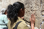 Israel, Jerusalem, Old City, Jewish Ethiopian Soldier prays at the Wailing Wall in the women's section