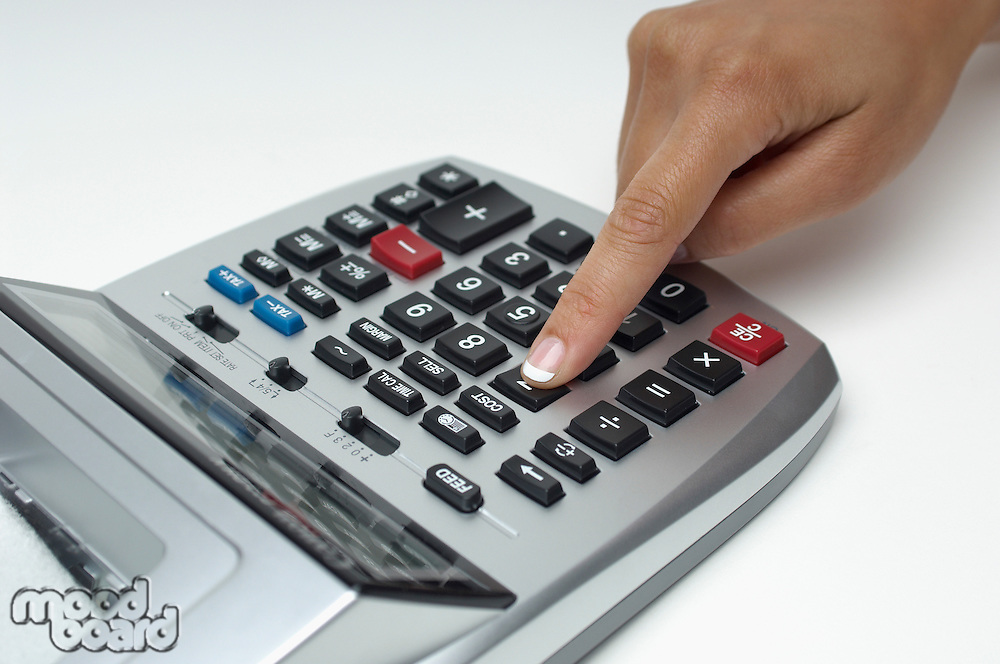 Woman using calculator, close-up of finger