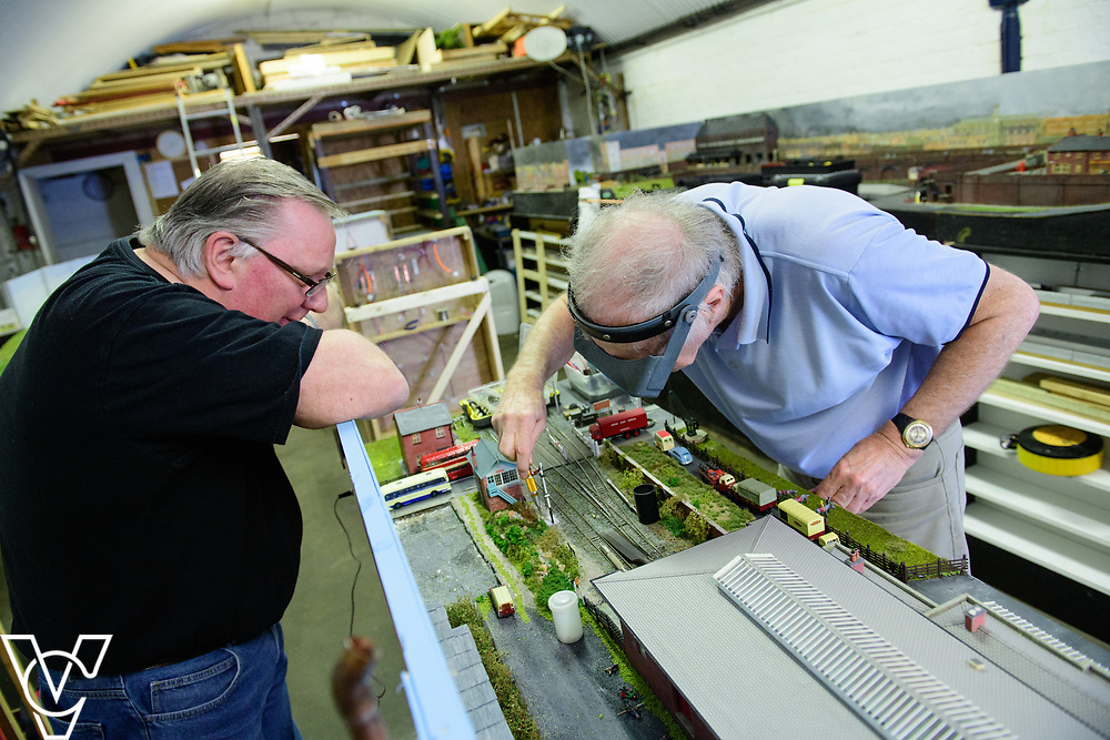 INSIGHT MAGAZINE: Bridlington Model Railway Society are based in Station Road, Bridlington, in a railway arch unit owned by Network Rail.  Pictured is Graham Wilson, left, and Neil Porter working on the model of Filey Station.<br /> <br /> Picture: Chris Vaughan Photography<br /> Date: May 31, 2017