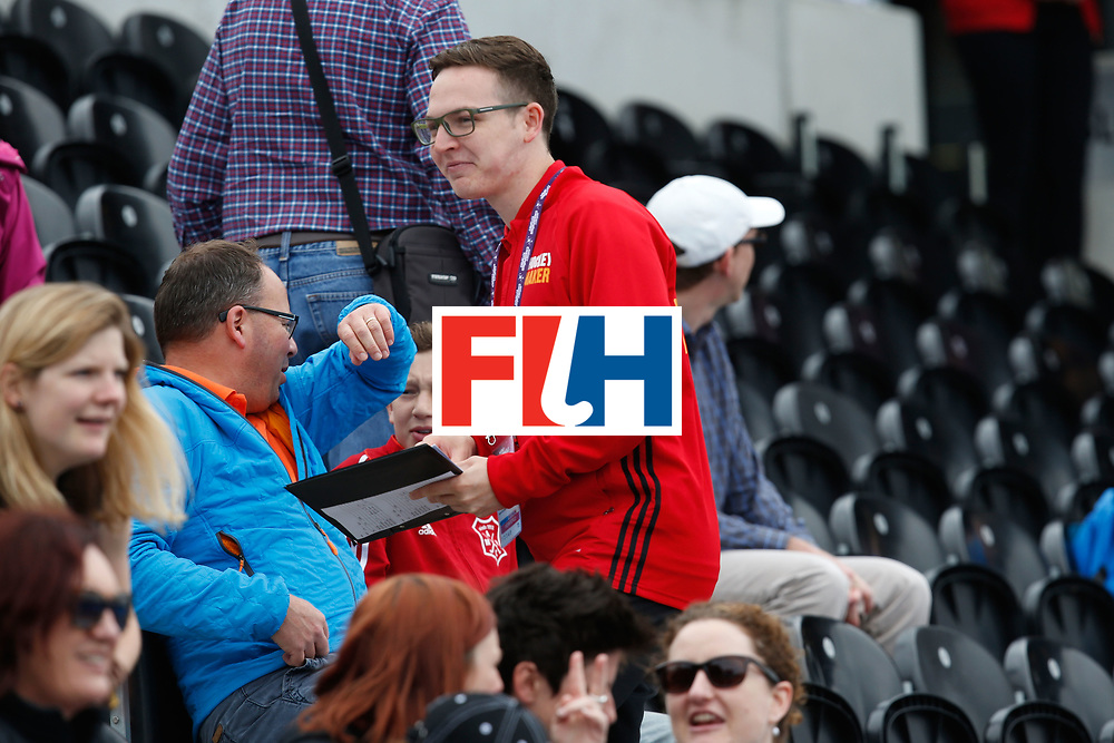 LONDON, ENGLAND - JUNE 18:  A volunteer helps spectators during the FIH Women's Hockey Champions Trophy 2016 match between United States and Australia at Queen Elizabeth Olympic Park on June 18, 2016 in London, England.  (Photo by Joel Ford/Getty Images)