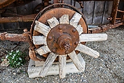 Broken wood wheel spokes. Barkerville Historic Town & Park, British Columbia, Canada. Historically the main town of the Cariboo Gold Rush, Barkerville is now the largest living-history museum in Western North America. The town was named after Billy Barker from Cambridgeshire, England, who struck gold here in 1861, and his claim became the richest and the most famous. This National Historic Site nestles in the Cariboo Mountains at elevation 1200m (4000ft), at the end of BC Highway 26, 80 kilometres (50 mi) east of Quesnel. Gold here was first discovered at Hills Bar in 1858, followed by other strikes in 1859 and 1860. Wide publication of these discoveries in 1861 began the Cariboo Gold Rush, which reached full swing by 1865 following strikes along Williams Creek.