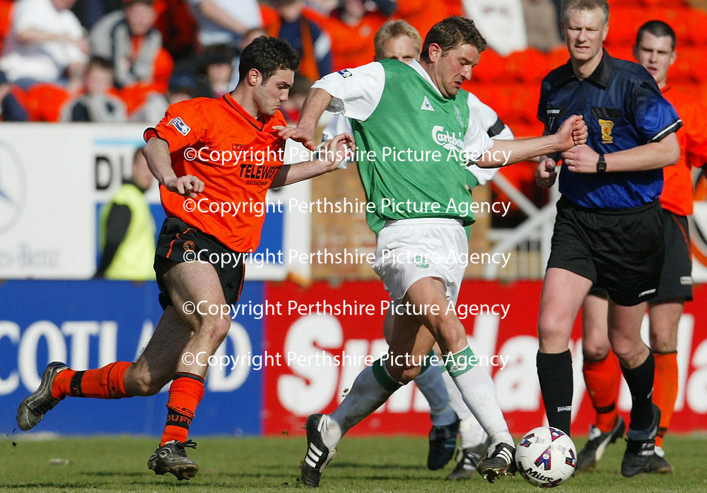 Dundee United v Hibs  07.04.02<br />Matthias Jack holds off Tassos Veneitis<br /><br />Pic by Graeme Hart<br />Copyright Perthshire Picture Agency<br />Tel: 01738 623350 / 07990 594431