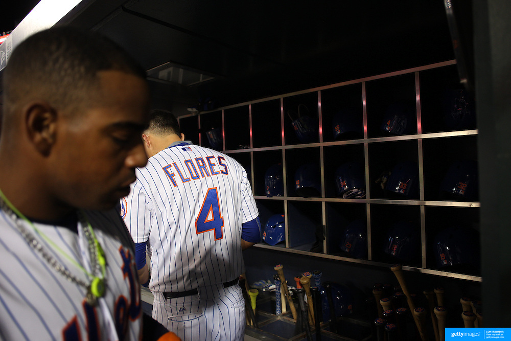 Yoenis Cespedes, (left) and Wilmer Flores, New York Mets, preparing to bat in the dugout during the New York Mets Vs Atlanta Braves MLB regular season baseball game at Citi Field, Queens, New York. USA. 22nd September 2015. Photo Tim Clayton