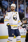 SHOT 3/28/15 7:40:18 PM - The Buffalo Sabres' Mike Weber #6 during a break in the action against the Colorado Avalanche in their regular season NHL game at the Pepsi Center in Denver, Co. The Avalanche won the game 5-3. (Photo by Marc Piscotty / © 2015)