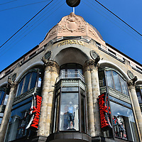 Metropol Store Façade in Copenhagen, Denmark <br /> This exquisite, art nouveau façade belonged to the Metropol Teatret when it opened in 1923.  This grand theater at the intersection of Strøget and Kattesundet was a popular venue for new release films.  When it closed in 1980 it became retail space and is currently occupied by the New Yorker clothing store. Fortunately they have done nothing to mar this beautify architecture.
