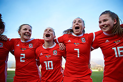ZENICA, BOSNIA AND HERZEGOVINA - Tuesday, November 28, 2017: Wales' Loren Dykes, Jessica Fishlock and Natasha Harding celebrate the 1-0 victory over Bosnia and Herzegovina during the FIFA Women's World Cup 2019 Qualifying Round Group 1 match between Bosnia and Herzegovina and Wales at the FF BH Football Training Centre. (Pic by David Rawcliffe/Propaganda)