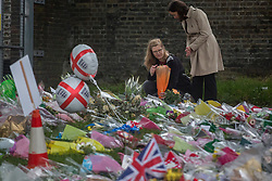© licensed to London News Pictures. London, UK 29/05/2013.Ingrid Loyau-Kennett (left), who confronted the  attackers in Woolwich terrorist attack, paying her respects at the scene where Drummer Lee Rigby was murdered by two men in Woolwich town centre. Photo credit: Tolga Akmen/LNP