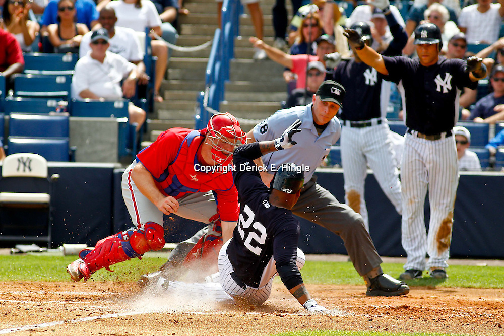 March 11, 2012; Tampa Bay, FL, USA; New York Yankees left fielder Andruw Jones (22) slides in safe past Philadelphia Phillies catcher Erik Kratz (31) scoring on a two run single by Chris Dickerson (not pictured) during the bottom of the fourth inning of a spring training game at George M. Steinbrenner Field. Mandatory Credit: Derick E. Hingle-USA TODAY SPORTS
