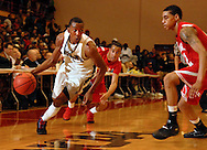 5 MARCH 2011 -- NORMANDY, Mo -- McCluer North High School basketball player BJ Young (1) drives to the basket past Chaminade College Prep defenders Solomon Bennett (2) and Tevin Evans (12) during the MSHSAA Class 5 boys basketball quarterfinals at Mark Twain Hall on the University of Missouri - St. Louis campus in Normandy, Mo. Saturday, March 5, 2011. The Stars upset the Red Devils 57-56 to advance to MSHSAA semifinals. Image © copyright 2011 Sid Hastings.