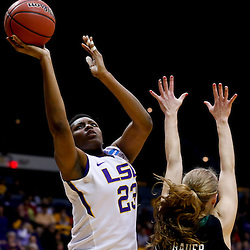 Mar 24, 2013; Baton Rouge, LA, USA; LSU Tigers forward Shanece McKinney (23) shoots over Green Bay Phoenix forward Lydia Bauer (22) in the first half of the first round of the 2013 NCAA womens basketball tournament at the Pete Maravich Assembly Center.  Mandatory Credit: Derick E. Hingle-USA TODAY Sports