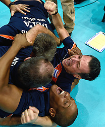 03-10-2015 NED: Volleyball European Championship Semi Final Nederland - Turkije, Rotterdam<br /> Nederland verslaat Turkije in de halve finale met ruime cijfers 3-0 / Coach Giovanni Guidetti gaat volledig uit zijn dak als Nederland zich plaatst voor de finale. Met Gil Ferrer Cutino, Rinke van den Brink en Assistent Coach Saskia van Hintum