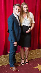 © Licensed to London News Pictures . FILE PICTURE DATED 16/05/2015 of swimmer Rebecca Adlington (r) , whilst pregnant with daughter Summer , with her husband Harry Needs (l) at The Palace Hotel , Manchester , UK . Adlington and Needs are to separate after 18 months of marriage . Photo credit : Joel Goodman/LNP