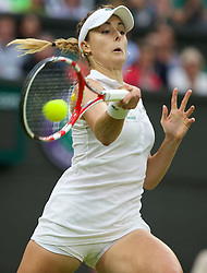 30.06.2014, All England Lawn Tennis Club, London, ENG, WTA Tour, Wimbledon, im Bild Alize Cornet (FRA) during the Ladies' Singles 4th Round match on day seven // 15065000 during the Wimbledon Championships at the All England Lawn Tennis Club in London, Great Britain on 2014/06/30. EXPA Pictures © 2014, PhotoCredit: EXPA/ Propagandaphoto/ David Rawcliffe<br /> <br /> *****ATTENTION - OUT of ENG, GBR*****