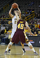 February 18, 2010: Iowa forward Kelsey Cermak (22) tries to keep the ball away from Minnesota forward Jackie Voigt (45) during the first half of the NCAA women's basketball game at Carver-Hawkeye Arena in Iowa City, Iowa on February 18, 2010. Iowa defeated Minnesota 75-54.