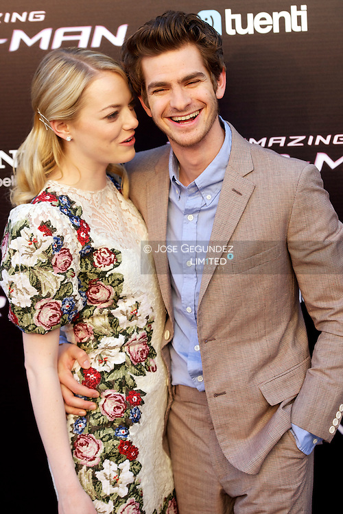 Actress Emma Stone and actor Andrew Garfield attend the premiere of 'The Amazing Spider-Man' at Callao Cinema in Madrid