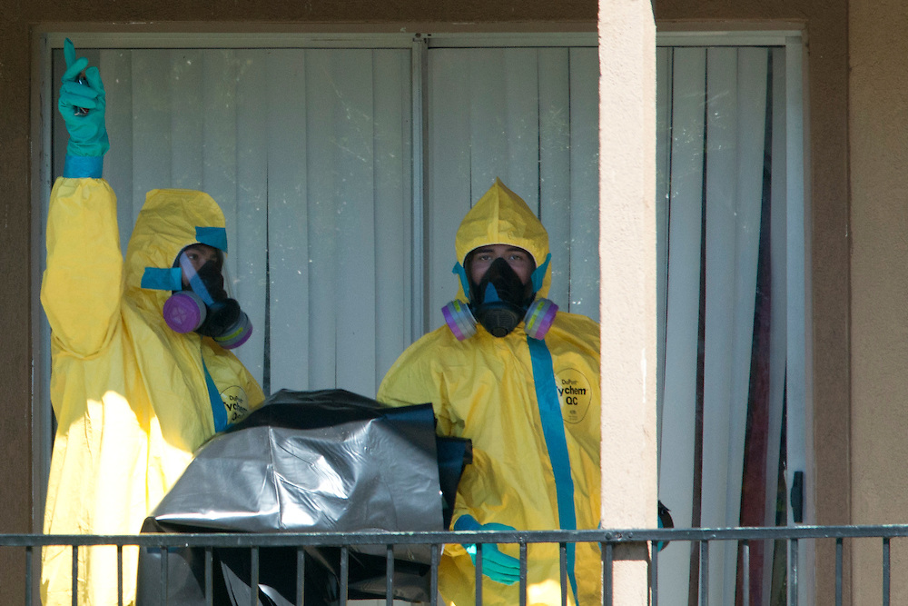 A haz-mat crew prepares to enter the Ivy Apartments where Thomas E. Duncan, the first confirmed Ebola virus patient in the United States, was staying with family in Dallas, Texas on October 3, 2014. Duncan is now being treated at Texas Health Presbyterian Hospital Dallas while members of his family have been isolated in the apartment. (Cooper Neill for The New York Times)]