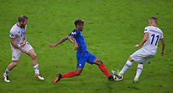 PARIS, FRANCE - Sunday, July 3, 2016: France's Kingsley Coman in action against Iceland's Alfred Finnbogason during the UEFA Euro 2016 Championship Semi-Final match at the Stade de France. (Pic by Paul Greenwood/Propaganda)