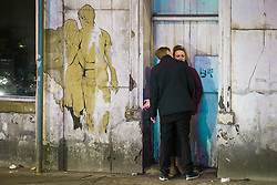 © Licensed to London News Pictures . Manchester , UK . 05/04/2015 . A man kisses a woman in a doorway on Dantzic Street in Manchester City Centre . Revellers on a Saturday night out during the Easter Bank Holiday weekend . Photo credit : Joel Goodman/LNP