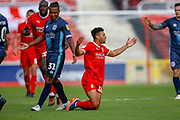 Swindon Town forward Keshi Anderson (10) appeals for  a foul during the EFL Sky Bet League 2 match between Swindon Town and Bury at the County Ground, Swindon, England on 15 September 2018.