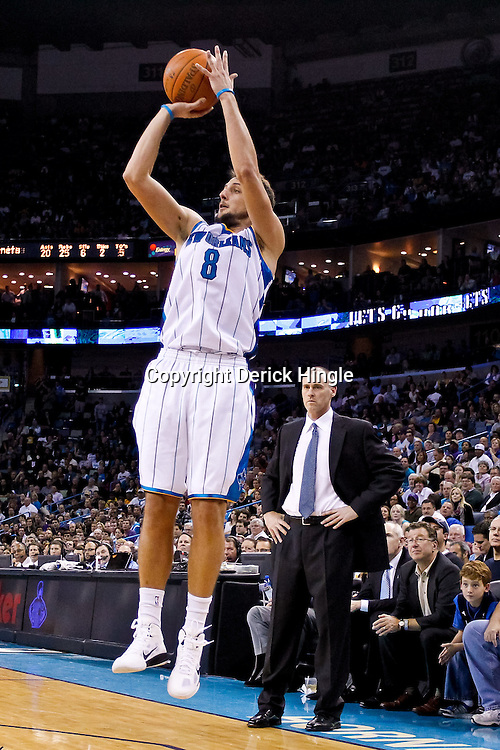 November 17, 2010; New Orleans, LA, USA; New Orleans Hornets shooting guard Marco Belinelli (8) of Italy shoots during the second half against the Dallas Mavericks at the New Orleans Arena. The Hornets defeated the Mavericks 99-97. Mandatory Credit: Derick E. Hingle