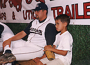 Marco on the bench with his Dad.