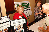 Terry Calico of Sinclair Workforce Development (left) during a Dayton Area Chamber of Commerce Business After Hours at the NCR Country Club in Kettering, Wednesday, July 25, 2012.  The Chamber will hold the 2012 Chamber Challenge, their 20th annual golf tournament and silent auction, at the NCR Country Club in September.