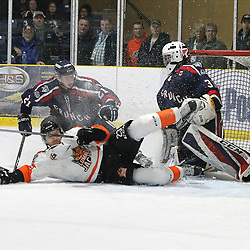 COCHRANE, ON - MAY 2: Troy Daniels #23 of the Hearst Lumberjacks is checked and goes sliding into the crease in overtime on May 2, 2019 at Tim Horton Events Centre in Cochrane, Ontario, Canada.<br /> (Photo by Tim Bates / OJHL Images)