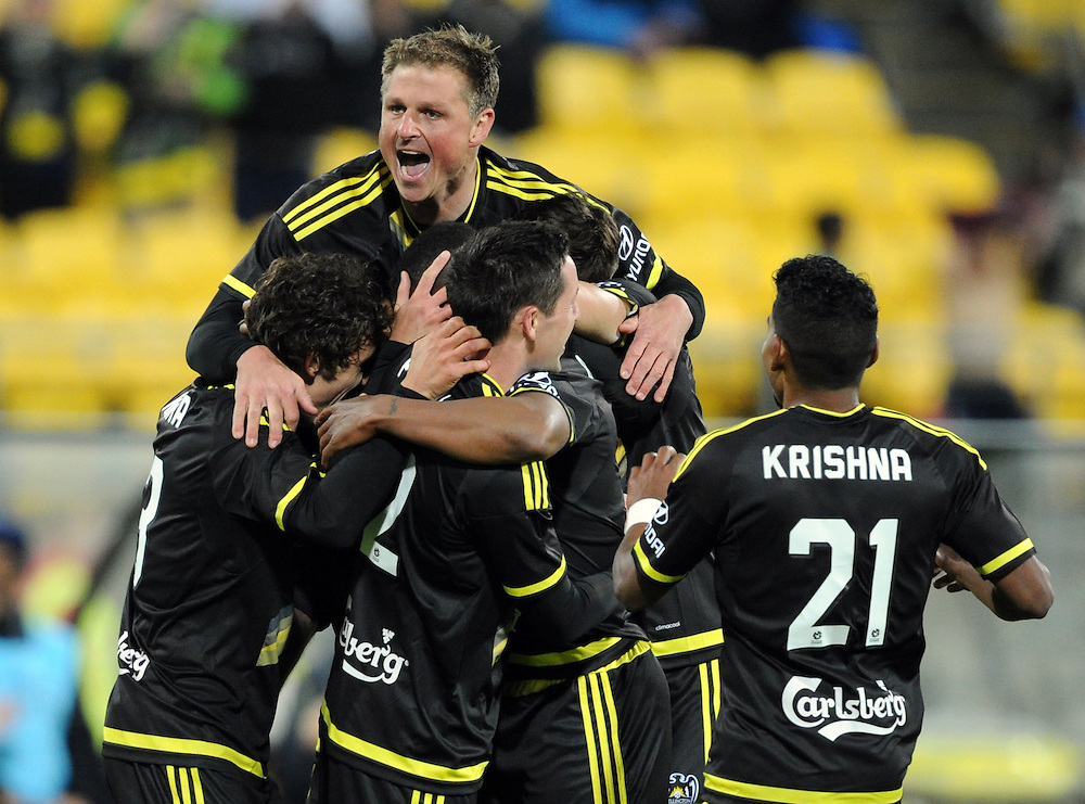 Phoenix's Ben Sigmund, top, helps celebrate a goal against Adelaide United in the A-League football match at Westpac Stadium, Wellington, New Zealand, Friday, November 13, 2015. Credit:SNPA / Ross Setford