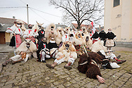 Busó carnival, Mohács, Hungary (7 February 2016). Pictured, a busó group poses for a photo beside the Serbian Orthodox church. The Busó carnival or Busójárás is inscribed on the UNESCO list of Intangible Cultural Heritage. © Rudolf Abraham