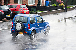 16:44 Ecclesfield Sheffield UK.The rain has deposited so much water it has flooded all the way across Minster Road..5 July 2012.Image © Paul David Drabble