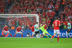 LILLE, FRANCE - Friday, July 1, 2016: Wales' goalkeeper Wayne Hennessey makes a save from Belgium's Thomas Meunier during the UEFA Euro 2016 Championship Quarter-Final match at the Stade Pierre Mauroy. (Pic by David Rawcliffe/Propaganda)