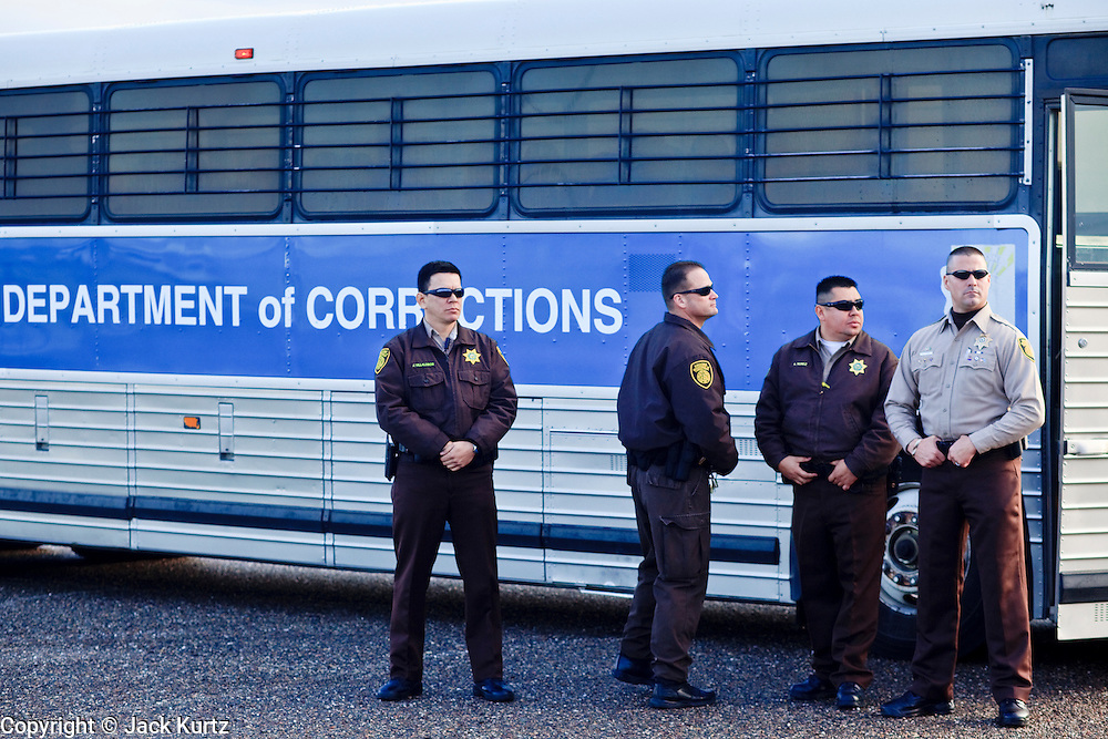 28 JANUARY 2010 -- BUCKEYE, AZ: Arizona Department of Corrections officers wait for federal authorities to show up to take control of 51 ADoC inmates. The Arizona Department of Corrections transferred 51 inmates from state control to the Immigration and Customs Enforcement at Lewis Prison in Buckeye Thursday morning. The inmates have less than 90 days left on their sentences and will be deported to their countries of origin when they finish their prison terms.  PHOTO BY JACK KURTZ